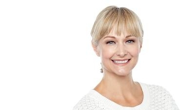 blonde woman with white shirt l cosmetic dentist northcote
